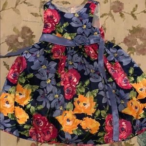 A beautiful blue dress with flowers on it
